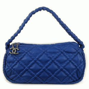 CHANEL Quilted Blue Handbag With CC Charm